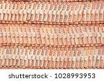 stacks of roof tiles. | Shutterstock . vector #1028993953