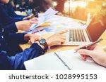 startup business team meeting... | Shutterstock . vector #1028995153