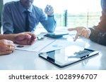 business team meeting working... | Shutterstock . vector #1028996707