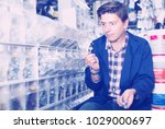 cheerful customer in hardware... | Shutterstock . vector #1029000697