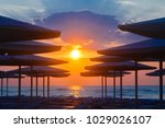 silhuettes of beach loungers... | Shutterstock . vector #1029026107
