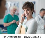 smiling woman at the hospital... | Shutterstock . vector #1029028153