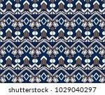 ikat geometric folklore... | Shutterstock .eps vector #1029040297