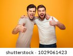 portrait of a two happy young... | Shutterstock . vector #1029061423