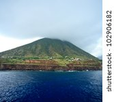 Volcano top in the clouds on Salina, Aeolian Islands, Sicily - stock photo