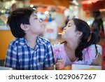 french fries on asian boy and... | Shutterstock . vector #1029067267