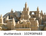 sand castle at the beach. | Shutterstock . vector #1029089683