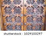 ancient engraved wooden  doors... | Shutterstock . vector #1029103297