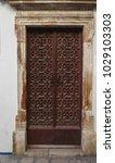 ancient engraved wooden  doors... | Shutterstock . vector #1029103303