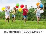 happy girls and boy running all ... | Shutterstock . vector #1029124987