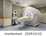 CT scanner in hospital with patient - stock photo
