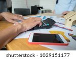 employees work with numbers. | Shutterstock . vector #1029151177