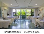 Hospital ward with beds and medical equipment - stock photo