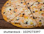pizza with pineapple on a...   Shutterstock . vector #1029273397