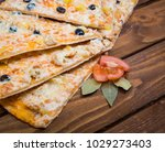 pizza with pineapple on a...   Shutterstock . vector #1029273403