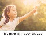 little girl blowing soap... | Shutterstock . vector #1029303283