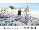 mum and teenager son walking... | Shutterstock . vector #1029328003