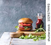 homemade burger in classic bun...   Shutterstock . vector #1029379993