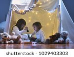 two little girls play at home... | Shutterstock . vector #1029403303