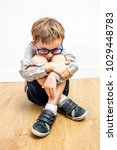 scared 7 year old child with... | Shutterstock . vector #1029448783