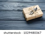 gift box wrapped in kraft paper ... | Shutterstock . vector #1029480367