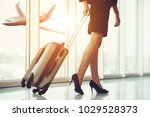 business woman traveling with... | Shutterstock . vector #1029528373