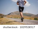 young man runner running on a... | Shutterstock . vector #1029528517