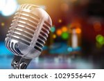 vintage metal microphone on a...   Shutterstock . vector #1029556447