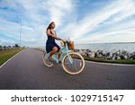 young woman riding a bicycle   Shutterstock . vector #1029715147