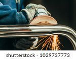 metal polishing with a hand... | Shutterstock . vector #1029737773