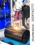 welding precision part by mig... | Shutterstock . vector #1029742777