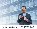 businessman holding mobile cell ... | Shutterstock . vector #1029789163