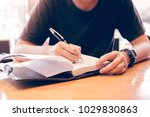 close up of young hand writing... | Shutterstock . vector #1029830863