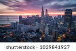 Small photo of San Francisco Skyline with Dramatic Clouds at Sunrise, California, USA