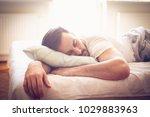 young man sleeping in bed.... | Shutterstock . vector #1029883963
