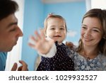 adorable girl playing with... | Shutterstock . vector #1029932527