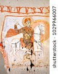 Small photo of Saint George killing the dragon. Interior of a cave church with early Christian Byzantine fresco - Cappadocia, Central Anatolia, Turkey