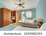 interior of a bedroom in a... | Shutterstock . vector #1029983293