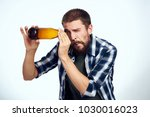 a man looks into the neck of a...   Shutterstock . vector #1030016023