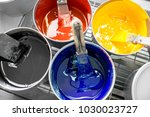 four open buckets with cmyk... | Shutterstock . vector #1030023727