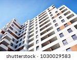 facade of a modern apartment... | Shutterstock . vector #1030029583