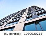 facade of a modern apartment... | Shutterstock . vector #1030030213
