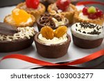 Small cakes with different stuffing - stock photo
