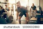 fit young man in sportswear... | Shutterstock . vector #1030032883