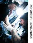 WARSAW - NOV 12: Tattooist makes a tattoo on his client's hand during the tattoo, body painting and pierceing show 'Body Art Convention' on 12th November, 2011 in Warsaw - stock photo