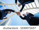 three business people join... | Shutterstock . vector #1030072657
