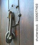it's an old rustic knocker... | Shutterstock . vector #1030077403