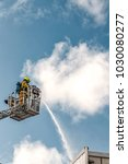 fireman with extinguisher hose... | Shutterstock . vector #1030080277