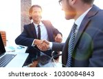 closeup. business handshake in... | Shutterstock . vector #1030084843