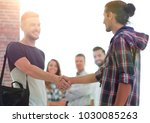 handshake staff of the agency | Shutterstock . vector #1030085263